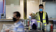 Iranians wearing face masks arrive at a metro station in the capital Tehran on June 10, 2020 amid the coronavirus Covid-19…
