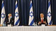 Israeli Prime Minister Benjamin Netanyahu (R) and alternate-PM and Defence Minister Benny Gantz attend the weekly cabinet…