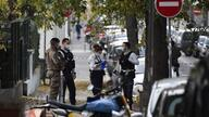 Security and emergency personnel are on October 31, 2020 in Lyon at the scene where an attacker armed with a sawn-off shotgun…