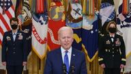 US President Joe Biden (C) speaks, flanked by the nominees to positions as 4-star Combatant Commanders General Jacqueline Van…