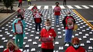 WASHINGTON, DC - MAY 12: Nurses affiliated with the group National Nurses United read the names of registered nurses who died…