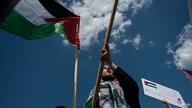 TOPSHOT - Activists and protesters march in support of Palestine near the Washington monument in Washington, DC on May 15, 2021…