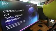 A woman checks the website of Israel-made Pegasus spyware at an office in the Cypriot capital Nicosia on July 21, 2021. -…