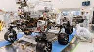 FILE - In this Dec. 17, 2019, file photo made available by NASA, engineers watch the first driving test for the Mars 2020 rover…