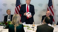LVMH CEO Bernard Arnault, left, and FIFA president Gianni Infantino, right, listen as President Donald Trump speaks during a…