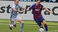 Barcelona's Lionel Messi, right, fights for the ball with Celta Vigo's Iago Aspas during a Spanish La Liga soccer match between…