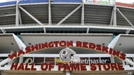 Signs for the Washington Redskins are displayed outside FedEx Field in Landover, Md., Monday, July 13, 2020. The Washington NFL…