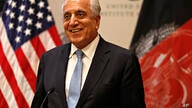 Special Representative for Afghanistan Reconciliation Zalmay Khalilzad approaches the microphone to speak on the prospects for…