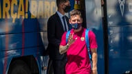 Barcelona's Lionel Messi waves as he arrives at the team hotel in Lisbon, Portugal, Thursday, Aug. 13, 2020. FC Barcelona are…