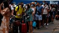 People wearing face masks to prevent the spread of coronavirus wait to board a ferry in the port of Piraeus, near Athens, on…