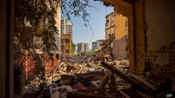 Destroyed buildings are seen from a room heavily damaged in a neighborhood near the site of last week's explosion that hit the…