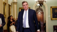 Sen. Mark Warner, D-Va., walks to the Senate chamber during a break in the impeachment trial of President Donald Trump at the…