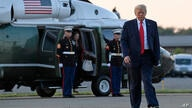 President Donald Trump walks from Marine One and heads over to talk with reporters before departing from Morristown Municipal…