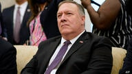 Secretary of State Mike Pompeo listens to a reporter's question during a meeting with President Donald Trump and Iraqi Prime…