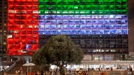 FILE - In this Aug. 13, 2020, file photo, Tel Aviv City Hall is lit up with the flag of the United Arab Emirates as UAE and…