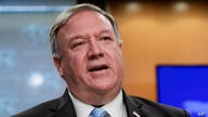 FILE - In this June 11, 2020, file photo, Secretary of State Mike Pompeo speaks at the State Department in Washington. The…