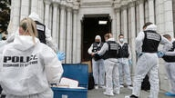 Forensic police officers inspect the scene of a knife attack at Notre Dame church in Nice, southern France, Thursday, Oct. 29,…