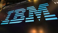 FILE - In this March 18, 2019, photo the logo for IBM appears above a trading post on the floor of the New York Stock Exchange…