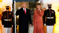 President Donald Trump and first lady Melania Trump greet trick-or-treaters on the South Lawn during a Halloween celebration at…