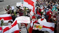 People, most of them elderly women, walk during an opposition rally in Minsk, Belarus, Monday, Oct. 19, 2020. The elderly…