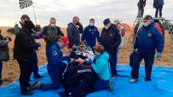 In this photo released by Roscosmos Space Agency, NASA astronaut Chris Cassidy sits in a chair shortly after landing near town…