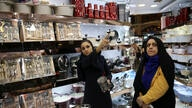 In this Thursday, Sept. 6, 2018, photo, Kiana Ismaili, 26, left, shops with her mother at a kitchenware shop ahead of her…