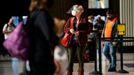 A woman makes her way through the 30th Street Station ahead of the Thanksgiving holiday, Friday, Nov. 20, 2020, in Philadelphia…