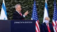 FILE - In this Oct. 28, 2020 file photo, Israeli Prime Minister Benjamin Netanyahu, left, and U.S. Ambassador to Israel David…