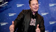 SpaceX owner and Tesla CEO Elon Musk arrives on the red carpet for the Axel Springer media award, in Berlin, Germany, Tuesday,…