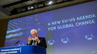 European Union foreign policy chief Josep Borrell takes off his protective face mask as he prepares to speak during a media…