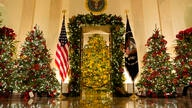 Cross Hall and the Blue Room are decorated during the 2020 Christmas preview at the White House, Monday, Nov. 30, 2020, in…