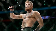 FILE - In this Oct. 6, 2018, file photo, Conor McGregor walks in the cage before fighting Khabib Nurmagomedov in a lightweight…