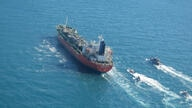 In this photo released Monday, Jan. 4, 2021, by Tasnim News Agency, a seized South Korean-flagged tanker is escorted by Iranian…