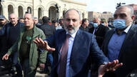 Armenian Prime Minister Nikol Pashinyan greets his supporters as he arrives at the main square in Yerevan, Armenia, Thursday,…