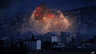 FILE - In this Oct. 20, 2014 file photo, thick smoke and flames erupt from an airstrike by the U.S.-led coalition in Kobani,…