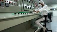 FILE - In this Feb. 3, 2007 file photo, a technician works at the Uranium Conversion Facility just outside the city of Isfahan,…