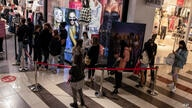 Consumers line up to enter a clothing store at a shopping center in the city of Beersheba, southern Israel, Sunday, Feb. 21,…