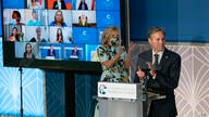 Secretary of State Antony Blinken and first lady Jill Biden, applaud during the 2021 International Women of Courage (IWOC)…