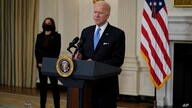 President Joe Biden, accompanied by Vice President Kamala Harris, speaks about efforts to combat COVID-19, in the State Dining…