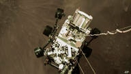 This Thursday, Feb. 18, 2021 photo provided by NASA shows the Perseverance rover lowered towards the surface of Mars during its…