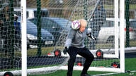 Britain's Prime Minister Boris Johnson stands in goal prior to a Juniors girls' soccer match between Hazel Grove United JFC and…