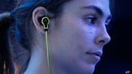 A model wears SMS Audio BioSport In-Ear Headphones at the Intel booth during the International CES, Tuesday, Jan. 6, 2015, in…