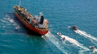 FILE - In this Monday, Jan. 4, 2021 file photo released by Tasnim News Agency, a seized South Korean-flagged tanker is escorted…