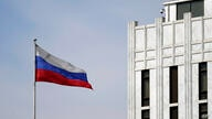 The Russian flag flies on the grounds of the Embassy of the Russian Federation in Washington, Thursday, April 15, 2021. The…