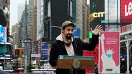 Actor Lin-Manuel Miranda delivers his remarks in Times Square after he toured the grand opening of a Broadway COVID-19…