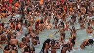 Devotees take holy dips in the Ganges River during Kumbh Mela, or pitcher festival, one of the most sacred pilgrimages in…