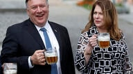 U.S. Secretary of State Mike Pompeo, left, and his wife Susan Pompeo hold a glass of beer during a visit at a brewery in Pilsen…
