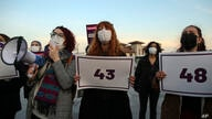 Protesters hold placards with numbers depicting women victims during a demonstration in Istanbul, Friday, April 2, 2021,…