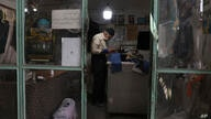 Tailor Akbar Momeni Jafari, 82, works at his shop in the bazaar of the town of Pishva, south of Tehran, Iran, Thursday, April 8…