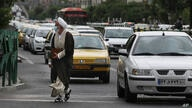 Traffic backs up at an intersection in downtown Tehran, Iran, Tuesday, May 11, 2021. (AP Photo/Vahid Salemi)